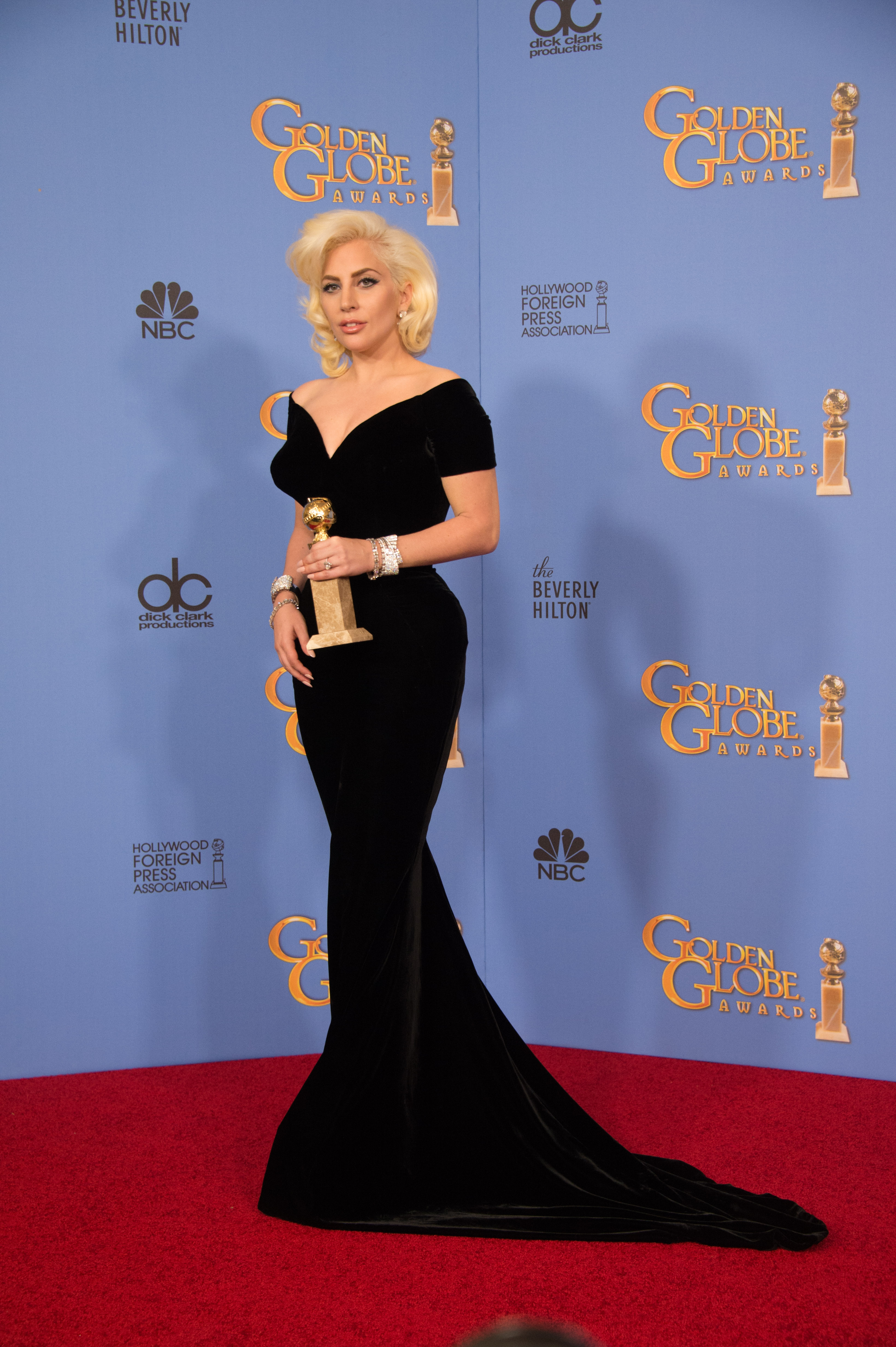 """After winning the category of BEST PERFORMANCE BY AN ACTRESS IN A MINI-SERIES OR MOTION PICTURE MADE FOR TELEVISION for her role in """"American Horror Story: Hotel,"""" actress Lady Gaga poses backstage in the press room with her Golden Globe Award at the 73rd Annual Golden Globe Awards at the Beverly Hilton in Beverly Hills, CA on Sunday, January 10, 2016."""